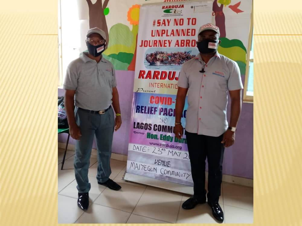 Raduja instructors with mask in front of educational seminar poster