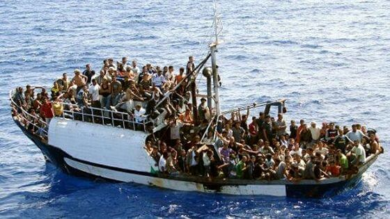 Overcrowded boat on the sea