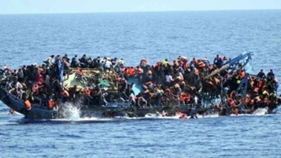 Overcrowded boat with refugees capsizes