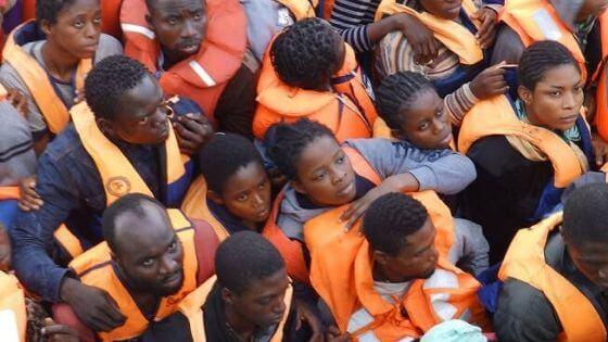 Refugees close together in life jackets