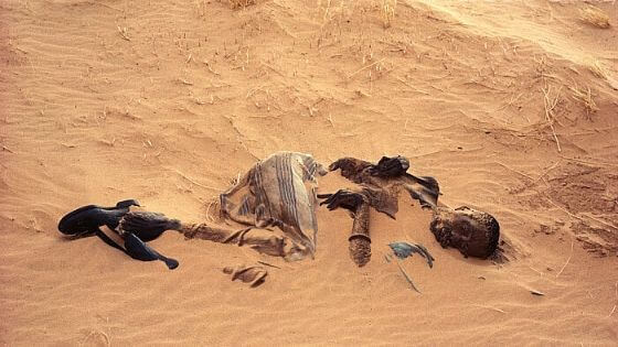 Body buried by sand in the desert
